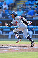 Rome Braves center fielder Cristian Pache (25) runs to first base during a game against the Asheville Tourists at McCormick Field on June 10, 2017 in Asheville, North Carolina. The Braves defeated the Tourists 4-2. (Tony Farlow/Four Seam Images)