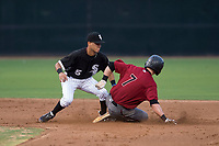 AZL White Sox shortstop Kevin Maldonado (5) applies the tag to Kevin Watson Jr. (7) during an Arizona League game against the AZL Diamondbacks at Camelback Ranch on July 12, 2018 in Glendale, Arizona. The AZL Diamondbacks defeated the AZL White Sox 5-1. (Zachary Lucy/Four Seam Images)