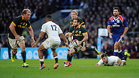 Cobus Reinach of South Africa evades the tackle attempt of Danny Care of England during the QBE International match between England and South Africa at Twickenham Stadium on Saturday 15th November 2014 (Photo by Rob Munro)