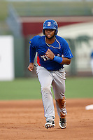 Fernando Vivili #66 of the AZL Rangers runs the bases against the AZL Royals at Surprise Stadium on July 15, 2013 in Surprise, Arizona. AZL Rangers defeated the AZL Royals, 3-2. (Larry Goren/Four Seam Images)