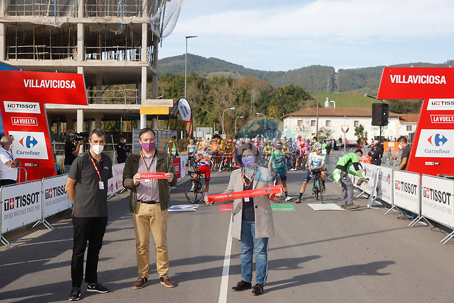 Cutting the ribbon for the start of Stage 11 of the Vuelta Espana 2020 running 170km from Villaviciosa to Alto de la Farrapona, Spain. 31st October 2020.    <br /> Picture: Luis Angel Gomez/PhotoSportGomez | Cyclefile<br /> <br /> All photos usage must carry mandatory copyright credit (© Cyclefile | Luis Angel Gomez/PhotoSportGomez)