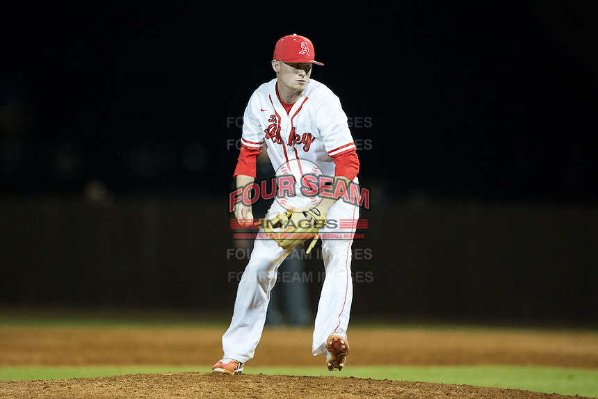 Belmont Abbey Crusaders relief pitcher Sam Luchansky (27) in action against the Catawba Indians at Abbey Yard on February 7, 2017 in Belmont, North Carolina.  The Crusaders defeated the Indians 12-9.  (Brian Westerholt/Four Seam Images)