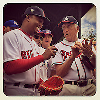 COOPERSTOWN, NY - MAY 24:  Instagram of Phil Niekro showing Pedro Martinez how to grip a knuckleball on the field before the Hall of Fame Classic game at Doubleday Field on May 24, 2014 in Cooperstown, New York. Photo by Brad Mangin