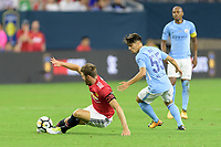 Houston, TX - Thursday July 20, 2017: Michael Carrick and Brahim Diaz during a match between Manchester United and Manchester City in the 2017 International Champions Cup at NRG Stadium.