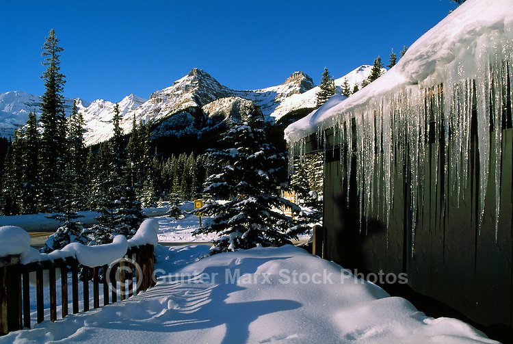 Icicles hanging from Snow Covered Deer Lodge at Lake Louise, Banff National Park, Alberta, Canada - Winter