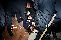 Police arrest OccupyBoston protesters at their second encampment at Rose F. Kennedy Greenway a block from Dewey Square, in downtown Boston, Massachusetts, USA.  The police and city officials warned protesters that they would be forceably removed from the site by midnight.  At about 1:30am police moved into the park, arrested approximately 100 protesters, and cleared the park of all tents and other protest materials.  The protesters are part of OccupyBoston, which is part of the OccupyWallStreet movement, expressing discontent with the socioeconomic situation of the 99% of the US population who are not wealthy.  Protestors have been camping in Dewey Square since Sept. 30, 2011. Gradually, larger organizations, including major labor unions, have expressed their support for the OccupyBoston effort.