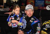 Feb. 27, 2011; Pomona, CA, USA; NHRA funny car driver Robert Hight holds daughter Autumn Hight after winning the Winternationals at Auto Club Raceway at Pomona. Mandatory Credit: Mark J. Rebilas-.