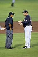 Kannapolis Intimidators manager Pete Rose Jr. (14) argues a call with umpire Takahito Matsuda during the game against the Augusta GreenJackets at CMC-NorthEast Stadium on July 31, 2014 in Kannapolis, North Carolina.  The Intimidators defeated the GreenJackets 4-3.  (Brian Westerholt/Four Seam Images)
