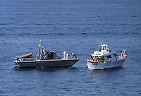 - motor patrol vessel of the Coastgard controls a yacht ....- motovedetta della Guardia Costiera controlla uno yacht