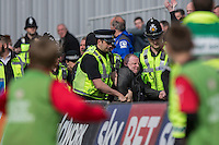 Following public police warnings of an emerging hooligan firm amongst Notts County supporters, a member of the travelling supporters is ejected during the Sky Bet League 2 match between Newport County and Notts County at Rodney Parade, Newport, Wales on 30 April 2016. Photo by Mark  Hawkins / PRiME Media Images.