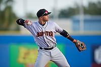 Jupiter Hammerheads third baseman J.C. Millan (24) throws during a game against the Dunedin Blue Jays on August 14, 2018 at Dunedin Stadium in Dunedin, Florida.  Jupiter defeated Dunedin 5-4 in 10 innings.  (Mike Janes/Four Seam Images)