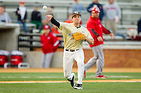Wake Forest Demon Deacons third baseman Mark Rhine (2) makes a throw to first base against the North Carolina State Wolfpack at Wake Forest Baseball Park on March 15, 2013 in Winston-Salem, North Carolina.  The Wolfpack defeated the Demon Deacons 12-6.  (Brian Westerholt/Four Seam Images)