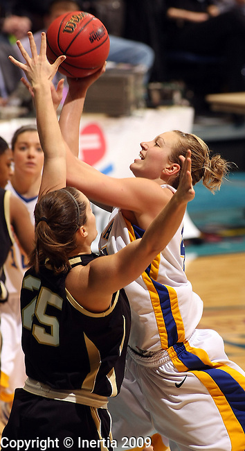 SIOUX FALLS, SD - MARCH 10:  Jennifer Warkenthien #44 of SDSU puts up a shot over Anna Patritto #25 of Oakland in the second half of their Summit League Championship game Tuesday afternoon at the Arena in Sioux Falls. (Photo by Dave Eggen/Inertia)