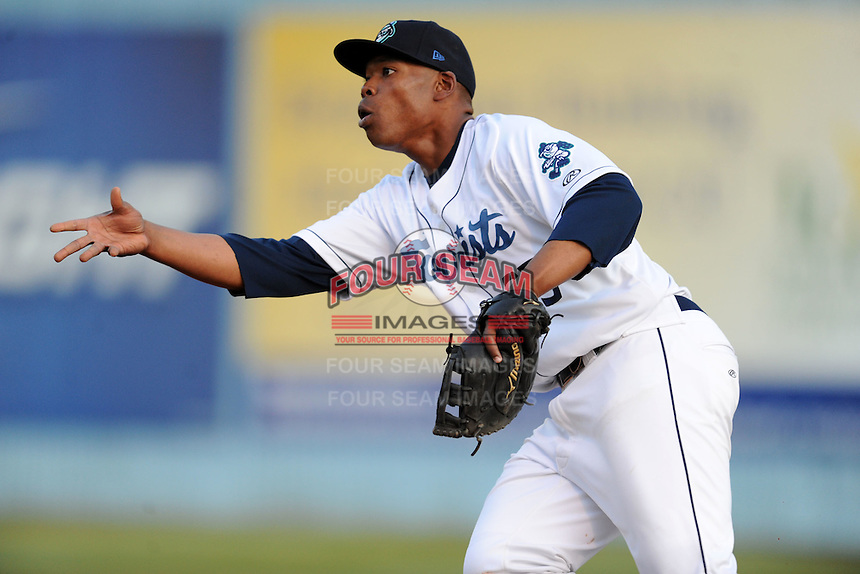 Asheville Tourists first baseman Harold Riggins #35 shovels the ball to the pitcher covering first during a game between the West Virginia Power and the Asheville Tourists at McCormick Field, Asheville, North Carolina April 9, 2012. The Tourists won 13-5  8-4  (Tony Farlow/Four Seam Images)..