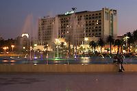 Tripoli, Libya - Grand Hotel (Funduk al-Kabir) and Fountain at Dusk