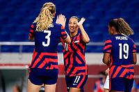 SAITAMA, JAPAN - JULY 24: Christen Press #11 of the United States celebrates scoring a goal during a game between New Zealand and USWNT at Saitama Stadium on July 24, 2021 in Saitama, Japan.
