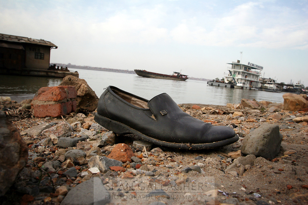 CHINA. Jiangxi Province.  Jiujiang. A shoe left on the banks of the Yangtze River. Jiujiang is a city of 4.6 million people, located on the southern shore of the Yangtze River. The Yangtze River is reported to be at its lowest level in 150 years as a result of a country-wide drought. It is China's longest river and the third longest in the world. Originating in Tibet, the river flows for 3,964 miles (6,380km) through central China into the East China Sea at Shanghai.  2008