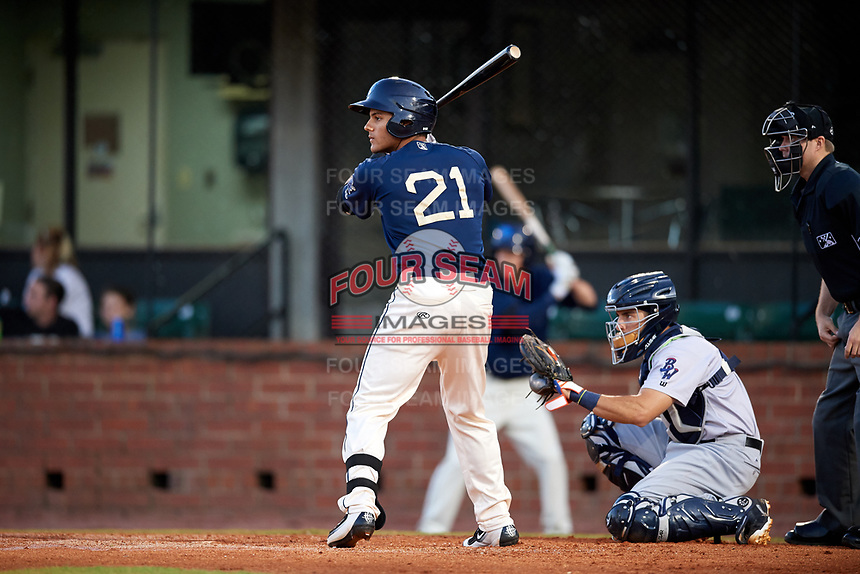 Mobile BayBears center fielder Michael Hermosillo (21) at bat in front of catcher Adrian Nieto (17) and home plate umpire Lewis Williams during a game against the Pensacola Blue Wahoos on April 25, 2017 at Hank Aaron Stadium in Mobile, Alabama.  Mobile defeated Pensacola 3-0.  (Mike Janes/Four Seam Images)