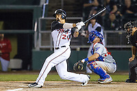 Lansing Lugnuts outfielder Josh Almonte (24) follows through on his swing against the South Bend Cubs on May 12, 2016 at Cooley Law School Stadium in Lansing, Michigan. Lansing defeated South Bend 5-0. (Andrew Woolley/Four Seam Images)
