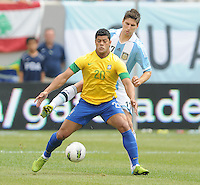 Brazil forward Hulk (20) shields the ball from Argentina Federico Fernandez (17) The Argentina National Team defeated Brazil 4-3 at MetLife Stadium, Saturday July 9 , 2012.
