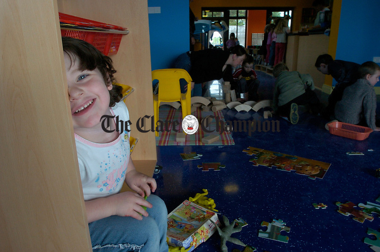 Chloe Howard plays hide and seek with the camera in the Ruan Childrens Centre. Photograph by John Kelly.