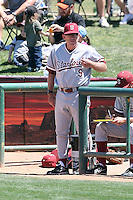 Mark Marquess #9, head coach of the Stanford Cardinal, gives signs to his battesr during a game against the Arizona State Sun Devils on May 1, 2011 at Packard Stadium, Arizona State University, in Tempe, Arizona. .Photo by:  Bill Mitchell/Four Seam Images.