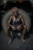 Hira Bhujian, a daily wage labourer poses for a portrait in Goladi coal depot in Jharia, outside of Dhanbad in Jharkhand, India.  Photo: Sanjit Das/Panos
