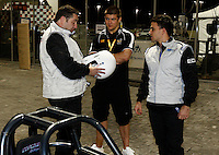 Photo: Richard Lane/Richard Lane Photography. London Wasps in Abu Dhabi for their LV= Cup game against Harlequins on 30st January 2011. 28/01/2011. Steve Hayes and Mark Hayes Nic Berry at a drag racing car at a raceway in Abu Dhabi.