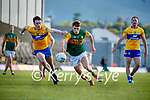 Joe McGann, Clare, in action against Gavin White, Kerry, during the Munster Football Championship game between Kerry and Clare at Fitzgerald Stadium, Killarney on Saturday.