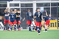 FOXBOROUGH, MA - JULY 25: New England Revolution celebrate their win at the end of the game during a game between CF Montreal and New England Revolution at Gillette Stadium on July 25, 2021 in Foxborough, Massachusetts.