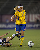 Second half substitute Sweden defender Sara Thunebro (6) dribbles through US defender tackle. The US Women's national team beat Sweden, 3-0, at Rentschler Field on July 17, 2010.