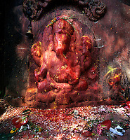 A much worshipped stone carved GANESH, the Elephant god held sacred by Buddhist & Hindu alike  - KATHMANDU, NEPAL