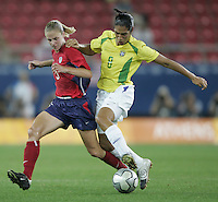 26 August 2004: Lindsay Tarpley dribbles the ball away from Brazil defender Daniela at Karaiskakis Stadium in Athens, Greece.   USA defeated Brazil 2-1 in overtime.   Credit: Michael Pimentel / ISI.