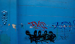 Graffiti on blue wall. Lima, Peru