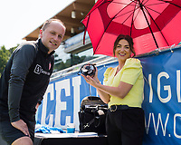 CARY, NC - SEPTEMBER 12: CBS sideline reporter Marisa Pilla shows Portland Thorns head coach Mark Parsons how she keeps cool before a game between Portland Thorns FC and North Carolina Courage at WakeMed Soccer Park on September 12, 2021 in Cary, North Carolina.