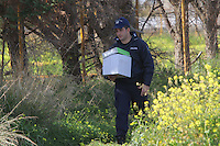 Pictured: Police forensics officers by the outhouse where the well is located where the remains of a body have been discovered in Malia, Creete, Greece. Monday 20 February 2017<br /> Re: Police have found the remains of the body in a well near a cemetery in Malia, on the Greek island of Crete with local news outlets speculating that it maybe that of 20 year old Briton Steven Cook who went missing on the 1st of September 2005. A disposable camera and a belt were reportedly found next to the remains.
