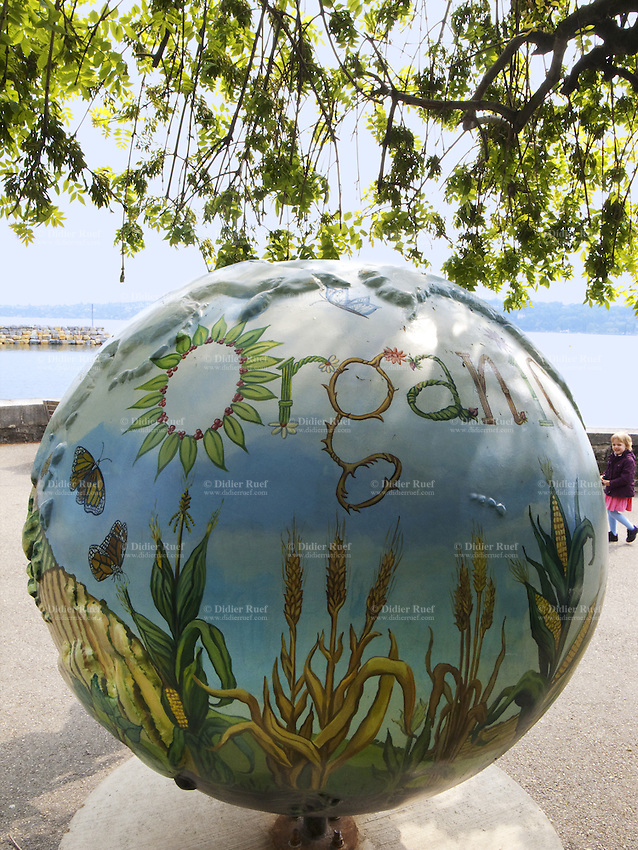 """Switzerland. Geneva. On the lakeside, at the end of Quai Wilson and in the Park Mon Repos. """"Cool Globes - Hot ideas for a cooler Planet"""" is a public art exhibition designed to raise awareness of solutions to climate change. Organic farming and a youth girl. Reusing products preserves natural resources. 16.05.10 © 2010 Didier Ruef"""