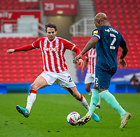 20th March 2021; Bet365 Stadium, Stoke, Staffordshire, England; English Football League Championship Football, Stoke City versus Derby County; Andre Wisdom of Derby County takes on Nick Powell of Stoke City