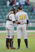 West Virginia Power catcher Reese McGuire (24) has a chat with starting pitcher Felipe Gonzalez (36) during the game against the Kannapolis Intimidators at CMC-Northeast Stadium on April 17, 2014 in Kannapolis, North Carolina.  The Power defeated the Intimidators 4-3.  (Brian Westerholt/Four Seam Images)