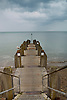 A jetty on Aberystwyth Promenade jutting out  into the Atlantic at Cardigan Bay.<br /> <br /> Stock Photo by Paddy Bergin