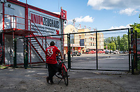 17th May 2020,Stadion An der Alten Försterei, Berlin, Germany; Bundesliga football, FC Union Berlin versus Bayern Munich;  A Bayern München fan standing in front of a closed entrance to the stadium leaning against his bicycle
