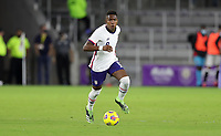 ORLANDO CITY, FL - JANUARY 31: Andres Perea #8 of the United States moves with the ball during a game between Trinidad and Tobago and USMNT at Exploria stadium on January 31, 2021 in Orlando City, Florida.