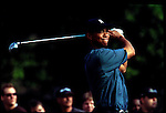 Tiger Woods watches his tee shot at the Genuity Open at Doral in Miami, Fl.