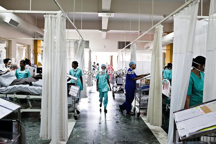 Nurses take care of patients after their open heart surgeries at the Intensive Care Unit of the Narayana Hrudayalaya in Bangalore, Karnataka, India. Photo: Sanjit Das/Panos