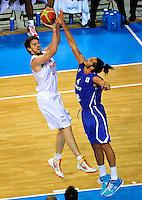 French national basketball team player Joakim Noah blocking Pau Gasol during final Eurobasket 2011 game between Spain and France in Kaunas, Lithuania, Sunday, September 18, 2011. (photo: Pedja Milosavljevic)