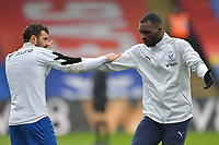 Christian Benteke of Crystal Palace and Luka Milivojević of Crystal Palace warm up before the Premier League behind closed doors match between Crystal Palace and Fulham at Selhurst Park, London, England on 28 February 2021. Photo by Vince Mignott / PRiME Media Images.