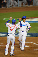 M.H. Kim greets teammate Shin Soo Choo of Korea during a game against Japan at the World Baseball Classic at Dodger Stadium on March 23, 2009 in Los Angeles, California. (Larry Goren/Four Seam Images)