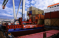 Containers being loaded on a cargo ship, Marseille Port, France.