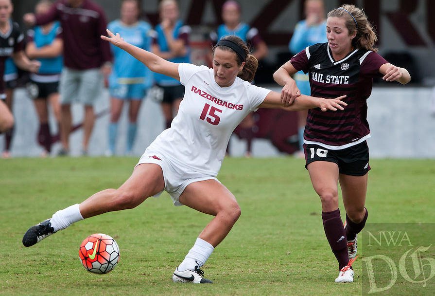 NWA Democrat-Gazette/BEN GOFF @NWABENGOFF<br /> Jessi Hartzler (15) of Arkansas attempts a shot on goal under pressure from Courtney Robicheaux in the first half on Sunday Sept. 20, 2015 during the match at Razorback Field in Fayetteville.