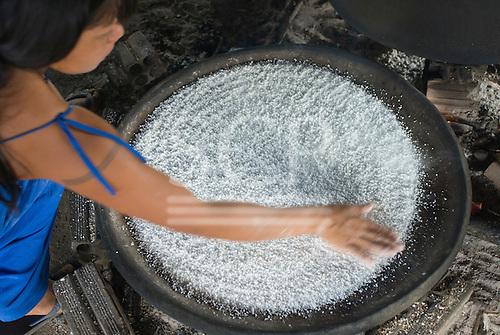 Xingu Indigenous Park, Mato Grosso State, Brazil. Aldeia Aweti. Making beju manioc bread.